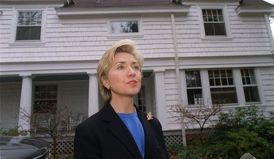 In this Nov. 3, 1999, file photo, then-first lady Hillary Rodham Clinton speaks to the media in front of the Clinton's newly purchased home in Chappaqua, N.Y. (AP Photo/Stephen Chernin, File)