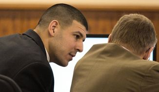 Former New England Patriots NFL football player Aaron Hernandez consults with his attorney Charles Rankin during his murder trial at Bristol County Superior Court, Wednesday, March 4, 2015, in Fall River, Mass. Hernandez is accused of the June 2013 killing of Odin Lloyd. (AP Photo/Dominick Reuter, Pool) ** FILE **