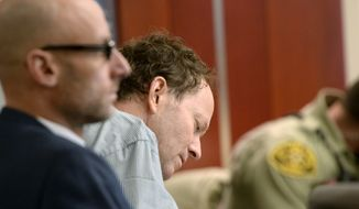 John Brickman Wall takes notes during testimony during his murder trial in Salt Lake City on Wednesday, March 4, 2015. Wall, a former Utah pediatrician, is accused of killing his ex-wife, Uta von Schwedler, at her Sugar House home in 2011. (AP Photo/The Salt Lake Tribune, Al Hartmann, Pool)
