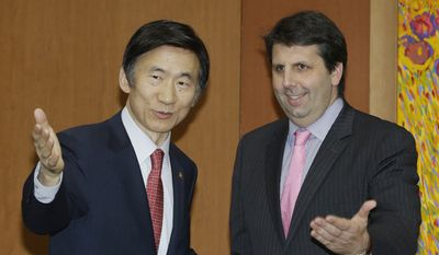 Mark Lippert, U.S. ambassador to South Korea, (right) is greeted by South Korean Foreign Minister Yun Byung-se during a meeting at the Foreign Ministry in Seoul, South Korea, Friday, Oct. 31, 2014. (Associated Press)