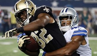 New Orleans Saints tight end Benjamin Watson (82) tries to break free from Dallas Cowboys free safety Barry Church (42) in Arlington, Texas, Sept. 28, 2014. (Associated Press) ** FILE **