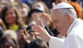 Pope Francis waves to faithful as he arrives for his weekly general audience in St. Peter's Square, at the Vatican, Wednesday, March 4, 2015. (AP Photo/Riccardo De Luca)