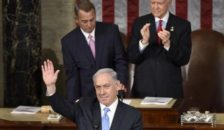 Israeli Prime Minister Benjamin Netanyahu waves as he speaks before a joint meeting of Congress on Capitol Hill in Washington, Tuesday, March 3, 2015. (AP Photo/Susan Walsh)