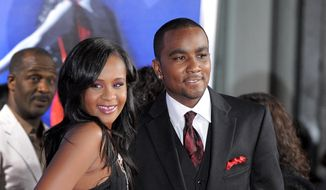 "In this Aug. 16, 2012, file photo, Bobbi Kristina Brown, left, and Nick Gordon attend the Los Angeles premiere of ""Sparkle"" at Grauman's Chinese Theatre in Los Angeles. (Photo by Jordan Strauss/Invision/AP, File)"