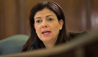 "Sen. Kelly Ayotte, New Hampshire Republican, said it was ""outrageous"" that Veterans Affairs staff who had manipulated patient wait-time data were awarded bonuses, and that the bonuses should be returned. (Associated Press)"