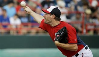 Washington Nationals starting pitcher Max Scherzer throws in the second inning of an exhibition spring training baseball game against the New York Mets, Thursday, March 5, 2015, in Viera, Fla. (AP Photo/David Goldman)