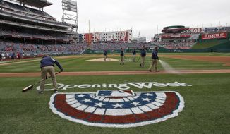The field is readied before a baseball home opener between the Washington Nationals Atlanta Braves at Nationals Park Friday, April 4, 2014, in Washington. (AP Photo/Alex Brandon)