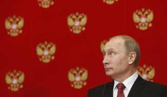 Russian President Vladimir Putin attends a news conference following a meeting with Italian Prime Minister Matteo Renzi in the Kremlin in Moscow, Russia, Thursday, March 5, 2015. (AP Photo/Sergei Karpukhin, Pool)