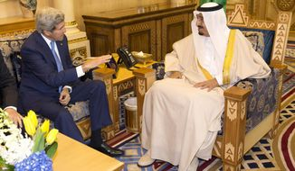 U.S. Secretary of State John Kerry, left, meets with Saudi King Salman bin Abdulaziz al-Saud at Diriya Farm, on Thursday, March 5, 2015, in Diriya, Saudi Arabia. Kerry planned to meet with Arab Gulf state allies in Riyadh Thursday before sitting down with the foreign ministers of France, Britain, and Germany in Paris on Saturday to share the state of the Iran nuclear negotiations. (AP Photo/Evan Vucci, Pool)