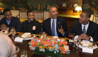 President Barack Obama hosts a lunch with My Brother's Keeper mentees in the Map Room of the White House in Washington int his Feb. 27, 2015, file photo. (AP Photo/Evan Vucci)