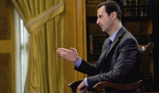 "In this photo released Wednesday, March 4, 2015, by the Syrian official news agency SANA, Syrian President Bashar Assad speaks during an interview with Portuguese state television, RTP, in Damascus, Syria. Assad denied that his troops drop barrels bombs on civilians telling a journalist: ""You are talking about massive propaganda."" (AP Photo/SANA)"