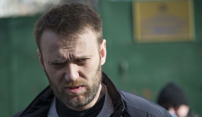 Russian opposition activist Alexei Navalny leaves a detention center in Moscow, Russia, Friday, March 6, 2015. Navalny, a leading opposition figure, was released after spending 15 days in custody for handing out leaflets in the subway. (AP Photo/Pavel Golovkin)