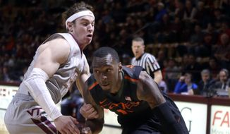 Miami's Sheldon McClellan, right, drives past Virginia Tech's Will Johnston during an NCAA college basketball game in Blacksburg Va. Saturday March 7 2015. (AP Photo/The Roanoke Times, Matt Gentry) )  LOCAL TELEVISION OUT; SALEM TIMES REGISTER OUT; FINCASTLE HERALD OUT;  CHRISTIANBURG NEWS MESSENGER OUT; RADFORD NEWS JOURNAL OUT; ROANOKE STAR SENTINEL OUT