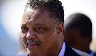 "The Rev. Jesse Jackson, left, speaks with supporters before President Barack Obama gives a speech and walks with others in a symbolic walk across the Edmund Pettus Bridge, Saturday, March 7, 2015, in Selma, Ala. This weekend marks the 50th anniversary of ""Bloody Sunday,' a civil rights march in which protestors were beaten, trampled and tear-gassed by police at the Edmund Pettus Bridge, in Selma. (AP Photo/Bill Frakes)"