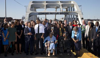 President Obama listens to Rep. John Lewis (D-Ga.), third from left, as they cross the Edmund Pettus Bridge in Selma, Ala., on the 50th anniversary of a turning point in the civil rights struggle. (AP Photo/Jacquelyn Martin)
