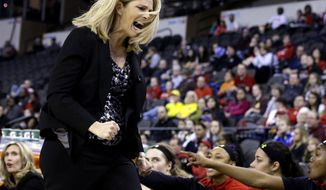 Maryland head coach Brenda Frese reacts to a call during the first half of an NCAA college basketball game against Ohio State in the final of the Big Ten Conference tournament in Hoffman Estates, Ill., on Sunday, March 8, 2015. (AP Photo/Nam Y. Huh)