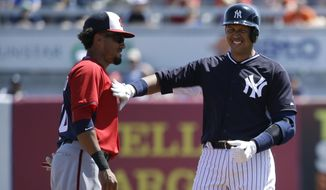 New York Yankees' Alex Rodriguez, right, jokes with Washington Nationals shortstop Ian Desmond, left, after hitting a double in the second inning during a spring training baseball exhibition game, Sunday, March 8, 2015, in Tampa, Fla. (AP Photo/Lynne Sladky)