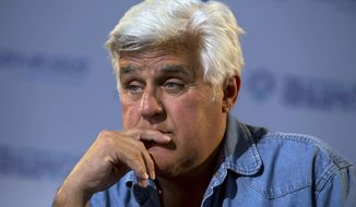 "FILE - In this May 21, 2014 file photo, American comedian Jay Leno pauses during an interview with The Associated Press in Jerusalem. Leno says he will return to Israel in June 2015 to host the award ceremony for the second annual ""Genesis Prize.""  The $1 million prize is being awarded to actor Michael Douglas in recognition of his support for Jewish causes. (AP Photo/Sebastian Scheiner, File)"