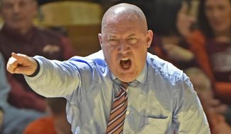 FILE - In this Jan. 3, 2015, file photo, Virginia Tech head coach Buzz Williams yells instructions to his players during the second half of an NCAA college basketball game against Syracuse in Blacksburg, Va. Williams' first season at Virginia Tech has been perhaps the most difficult of his career. (AP Photo/Don Petersen, File)