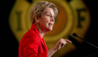 Sen. Elizabeth Warren, Massachusetts Democrat, got an enthusiastic reception at the International Association of Firefighters Legislative Conference and Presidential Forum Monday. (Associated Press)