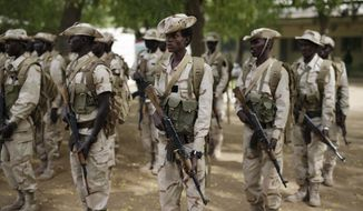"Chadian troops participate in the closing ceremony of operation Flintlock in an army base in N'djamena, Chad, Monday March 9, 2015. The U.S. military and its Western partners conduct this training annually and set up plans long before Boko Haram began attacking its neighbors Niger, Chad and Cameroon. Chadian Brig. Gen. Zakaria Ngobongue said Monday that his soldiers alongside troops from Niger had entered Nigeria but he declined to give further details about the ongoing operation. Ngobongue described Boko Haram fighters as ""bandits and criminals who have nothing to do with religion."" (AP Photo/Jerome Delay)"