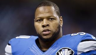 FILE - In this Nov. 9, 2014, file photo, Detroit Lions defensive tackle Ndamukong Suh (90) is shown before an NFL football game against the Miami Dolphins at Ford Field in Detroit. When NFL free agency begins Tuesday, March 10, 2015,  lots of players will get lots of money. Some will even earn it throughout those massive contracts. Lions defensive tackle Ndamukong Suh and Cowboys running back DeMarco Murray, the AP Offensive Player of the Year and league's leading rusher, will be available.  (AP Photo/Rick Osentoski, File)