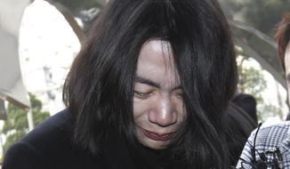 Cho Hyun-ah, former vice president of Korean Air Lines Co., arrives at the Seoul Western District Prosecutors Office in Seoul, South Korea, in this Dec. 30, 2014, file photo. A flight attendant who was harassed by Cho in what became known as the nut rage case filed a civil lawsuit against the airline and the executive. (AP Photo/Ahn Young-joon, File)