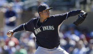 Seattle Mariners' Felix Hernandez works against the Colorado Rockies in the first inning of a spring training exhibition baseball game Tuesday, March 10, 2015, in Scottsdale, Ariz. (AP Photo/Ben Margot)