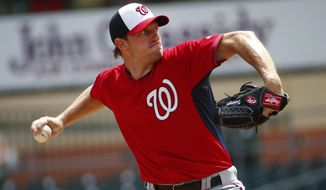Washington Nationals starting pitcher Max Scherzer works in the first inning of an exhibition spring training baseball game against the Miami Marlins, Tuesday, March 10, 2015, in Jupiter, Fla. (AP Photo/John Bazemore)