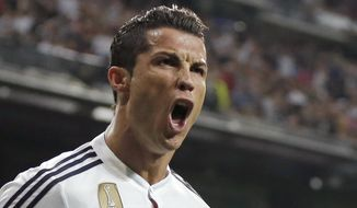 Real Madrid's Cristiano Ronaldo celebrates scoring 2-2 during a Champions League soccer match round of 16 second leg, between Real Madrid and Schalke 04 at Santiago Bernabeu stadium, in Madrid, Spain, Tuesday, March 10, 2015. (AP Photo/Daniel Ochoa de Olza)