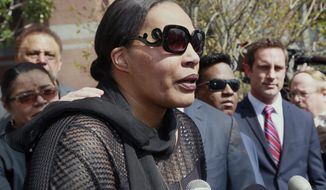 "Marvin Gaye's daughter, Nona Gaye, talks to the media outside the Los Angeles U.S. District Court after a jury awarded the singer's children nearly $7.4 million after determining singers Robin Thicke and Pharrell Williams copied their father's music to create ""Blurred Lines,"" Tuesday, March 10, 2015. Nona Gaye wept as the verdict was read and was hugged by her attorney. (AP Photo/Nick Ut)"
