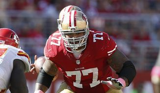 FILE - In this Oct. 5, 2014, file photo, San Francisco 49ers guard Mike Iupati (77) blocks against the Kansas City Chiefs during the second half of an NFL football game in Santa Clara, Calif. NFL free agency begins Tuesday, March 10, 2015. (AP Photo/Tony Avelar)