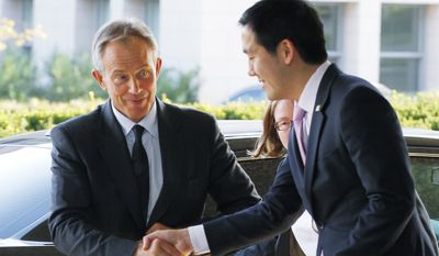 Deputy Chief of Protocol Dennis Cheng (right) greets former British Prime Minister and Quartet Representative Tony Blair upon arrival at the State Department in Washington for a meeting with Secretary of State Hillary Rodham Clinton on Aug. 31, 2010. (Associated Press)