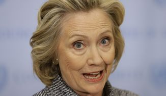 """Hillary Rodham Clinton speaks to the reporters at United Nations headquarters, Tuesday, March 10, 2015.   Clinton conceded that she should have used a government email to conduct business as secretary of state, saying her decision was simply a matter of """"convenience.""""  (AP Photo/Seth Wenig)"""