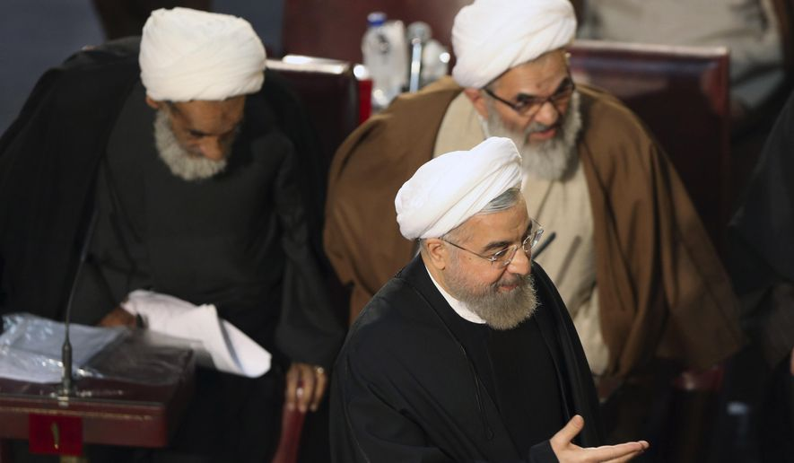 Iranian President Hassan Rouhani, who is also a member of the Assembly of Experts, arrives to attend a biannual meeting of the assembly in Tehran, Iran, Tuesday, March 10, 2015. Iran's most influential clerical body charged with choosing or dismissing the nation's supreme leader has elected a hard-line ayatollah as its new chairman, the official IRNA news agency reported on Tuesday. IRNA said Mohammad Yazdi, the deputy chairman of the 86-member Assembly of Experts, got 47 votes in his favor from among 73 clerics who attended the session. (AP Photo/Vahid Salemi)