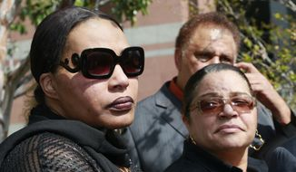 "Marvin Gaye's daughter, Nona Gaye, left, and his ex-wife, Jan Gaye, take questions from the media outside Los Angeles U.S. District Court, after a jury awarded the singer's children nearly $7.4 million after determining singers Robin Thicke and Pharrell Williams copied their father's music to create ""Blurred Lines,"" Tuesday, March 10, 2015. Nona Gaye wept as the verdict was read and was hugged by her attorney. (AP Photo/Nick Ut)"