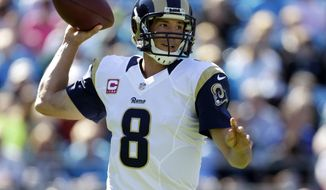 FILE - In this Oct. 20, 2103, file photo, St. Louis Rams quarterback Sam Bradford  looks to pass against the Carolina Panthers in the first half of an NFL football game in Charlotte, N.C. Two people familiar with the trade say the Philadelphia Eagles and St. Louis Rams have agreed to swap quarterbacks Nick Foles and Sam Bradford. Both people spoke to The Associated Press on condition of anonymity Tuesday, March 10, 2015, because the teams are still working on the draft picks involved in the deal.  (AP Photo/Bob Leverone, File)