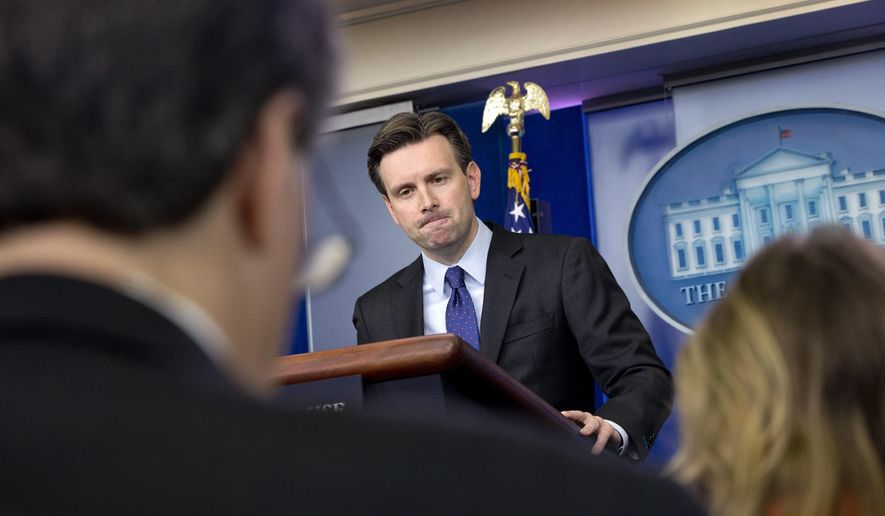 White House press secretary Josh Earnest listens to a question about former Secretary of State Hillary Rodham Clinton's emails during his daily news briefing at the White House in Washington, Wednesday, March 11, 2015. Questions ranged from the Islamic State to Mrs. Clinton's emails to Ukraine. (AP Photo/Jacquelyn Martin)