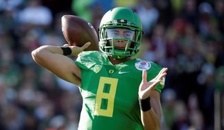 Oregon quarterback Marcus Mariota will be taken fifth in the NFL draft by the Redskins, if he falls to them, according to ESPN reporter John Clayton in a recent radio interview. (Associated Press)