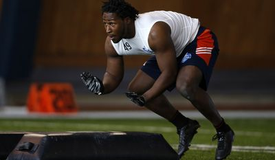 Takari Johnson, of Concordia University Ann Arbor, runs through drills during an NFL Regional Combine on Saturday, March 7, 2015, in Lake Forest, Ill. (AP Photo/Andrew A. Nelles)