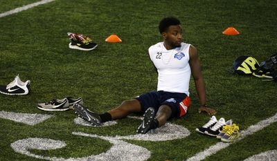 Carroll Washington, of The University of Arkansas, rests between drills during an NFL Regional Combine on Saturday, March 7, 2015, in Lake Forest, Ill. (AP Photo/Andrew A. Nelles)