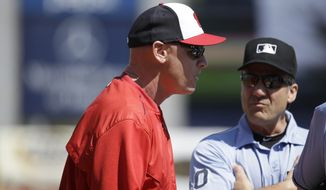Washington Nationals manager Matt Williams, left, talks with the umpires before a spring training baseball exhibition game against the New York Yankees, Sunday, March 8, 2015, in Tampa, Fla. (AP Photo/Lynne Sladky)