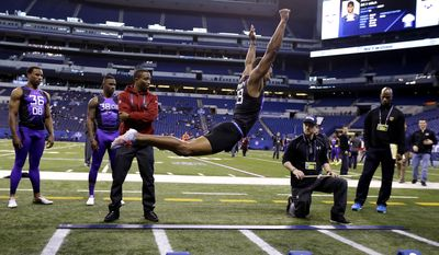 Wake Forest defensive back Kevin Johnson runs a drill at the NFL football scouting combine in Indianapolis, Monday, Feb. 23, 2015. (AP Photo/Julio Cortez)