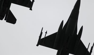 U.S. Air Force jets fly over FedEx Field during the NFL's Salute to Service before an NFL football game between the Washington Redskins and the Tampa Bay Buccaneers in Landover, Md., Sunday, Nov. 16, 2014. (Associated Press)