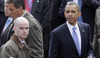 President Obama pauses as he shakes hands with people in the crowd after speaking at College Green in Dublin, Ireland, on May 23, 2011, while Mark Connolly (far left), the second-in-command on Obama's security detail, stands by. The Homeland Security Department is investigating Connolly and another senior Secret Service agent accused of crashing a car into a White House security barrier, an agency spokesman says. (Associated Press)