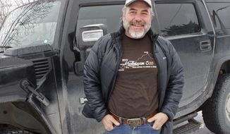 FILE - In this photo taken Sunday, March 1, 2015 file photo, musher Scott Janssen poses in Anchorage, Alaska. Jansen was knocked unconscious and removed from the Iditarod Trail Sled Dog Race last year when he broke an ankle. Iditarod officials says because of warm weather and barren trails south of the Alaska Range, the conditions are worse this year, and they have moved the official start of the race from the greater Anchorage area to Fairbanks, Alaska. (AP Photo/Mark Thiessen, File)