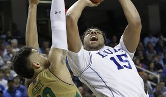 Duke's Jahlil Okafor (15) shoots over Notre Dame's Zach Auguste (30) during the second half of an NCAA college basketball game in the semifinals of the Atlantic Coast Conference tournament in Greensboro, N.C., Friday, March 13, 2015. (AP Photo/Gerry Broome)