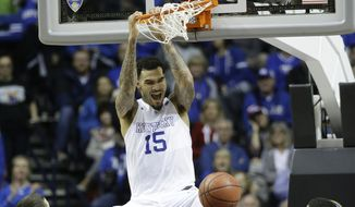 Kentucky forward Willie Cauley-Stein (15) dunks the ball as Auburn forward Alex Thompson (20) and Auburn guard Devin Waddell look on during the second half of an NCAA college basketball game in the semifinal round of the Southeastern Conference tournament, Saturday, March 14, 2015, in Nashville, Tenn. (AP Photo/Mark Humphrey)