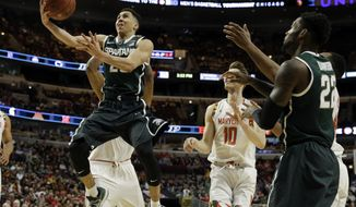 Michigan State's Travis Trice (20) shoots in front of Maryland's Jake Layman (10) in the second  half of an NCAA college basketball game in the semifinals of the Big Ten Conference tournament in Chicago, Saturday, March 14, 2015. (AP Photo/Nam Y. Huh)