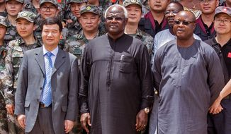 "FILE  -In this file photo taken on Sept. 25, 2015, Chinese Ambassador Zhao Yanbo, left, stand next to Sierra Leone's president Ernest Bai Koroma, center, and  Sierra Leone's  Vice President Samuel Sam-Sumana,  right, during the opening ceremony of  the China Friendship Hospital catering for Ebola virus patience in Freetown, Sierra Leone. Sierra Leone's vice president sought asylum on the United States on Saturday, March 14, 2015, saying he no longer felt safe in the country after soldiers disarmed the security team at his residence. ""I don't feel safe this morning as vice president,"" Samuel Sam-Sumana told The Associated Press by phone.  (AP Photo/ Michael Duff,File)"